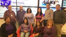 Comcasters wear purple to support Spirit Day
