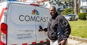 man with a comcast truck