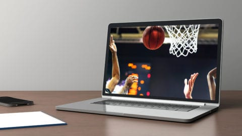 open laptop showing basketball game streaming