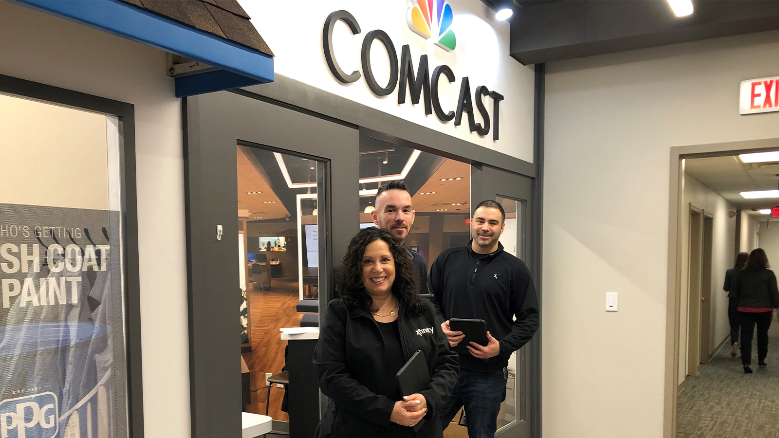 Comcast employees in front of store in BizTown