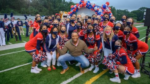 Craig Melvin surrounded by cheerleaders